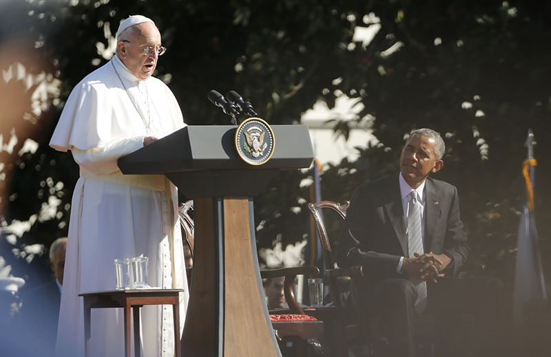 U.S. President Barack Obama listens as Pope Francis speaks during an arrival ceremony for the pope at the White House in Washington on September 23, 2015. The pontiff is on his first visit to the United States. Photo courtesy of REUTERS/Jonathan Ernst *Editors: This photo may only be republished with RNS-POPE-OBAMA, originally transmitted on Sept. 23, 2015.